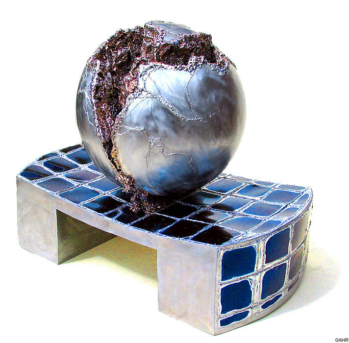 Stainless Steel and Bronze Ball Fountain on a Blue Pedestal